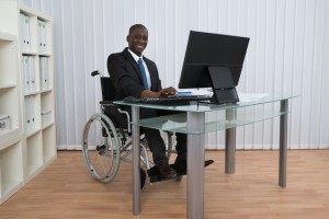 disabled worker at desk
